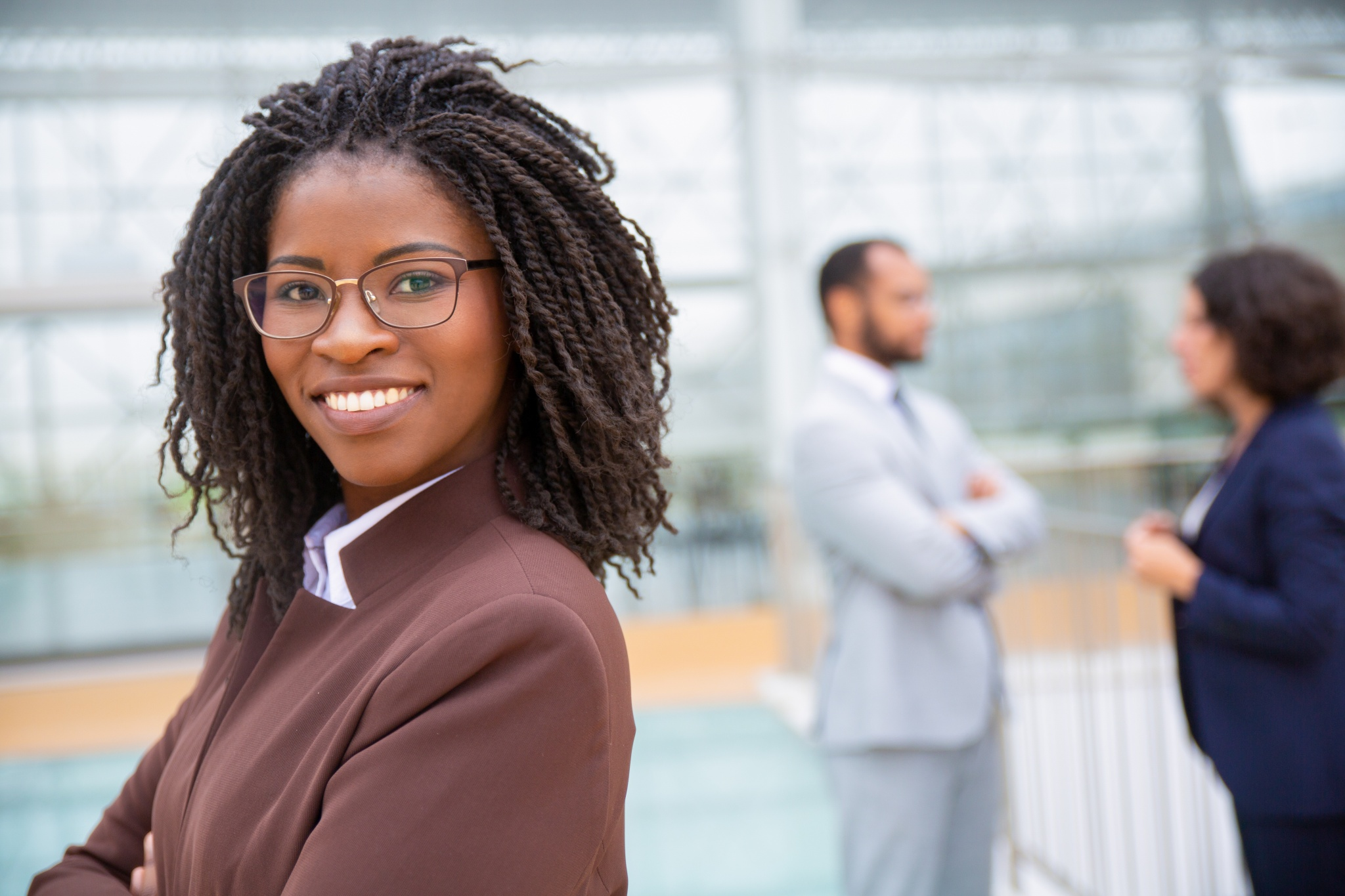 Cheerful young businesswoman in eyeglasses. Portrait of happy young African American businesswoman smiling at camera. Leader concept